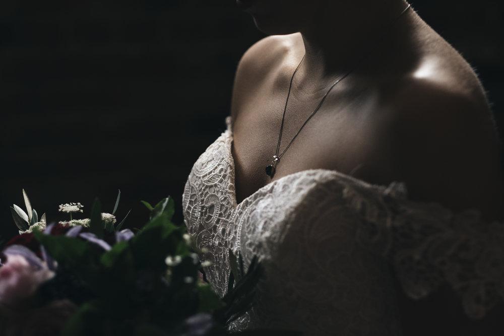 Bride on Wedding Day Poses in Dress for Toledo Ohio Wedding Photographers Inspiration