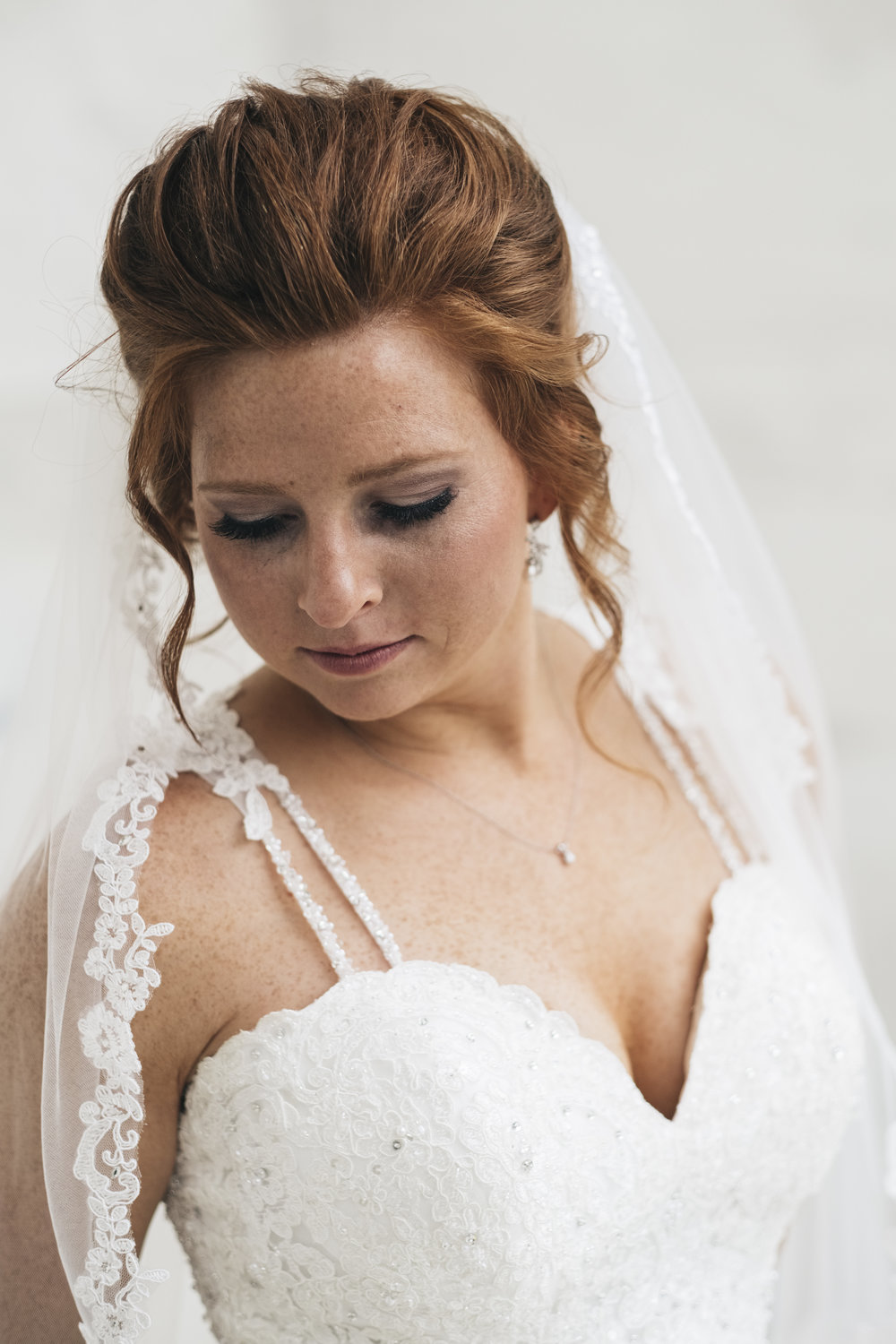 Bride on Wedding Day in Dress with Wedding Photographers from Toledo Ohio