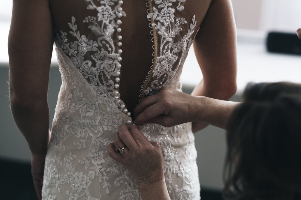 Back of Wedding Dress with Lace and Beads on Bride in Toledo Ohio with Photographers