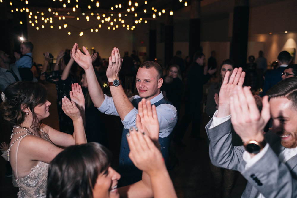 Bride and Groom Dance Together on Wedding Night at Reception with Toledo Wedding Photographers in Ohio