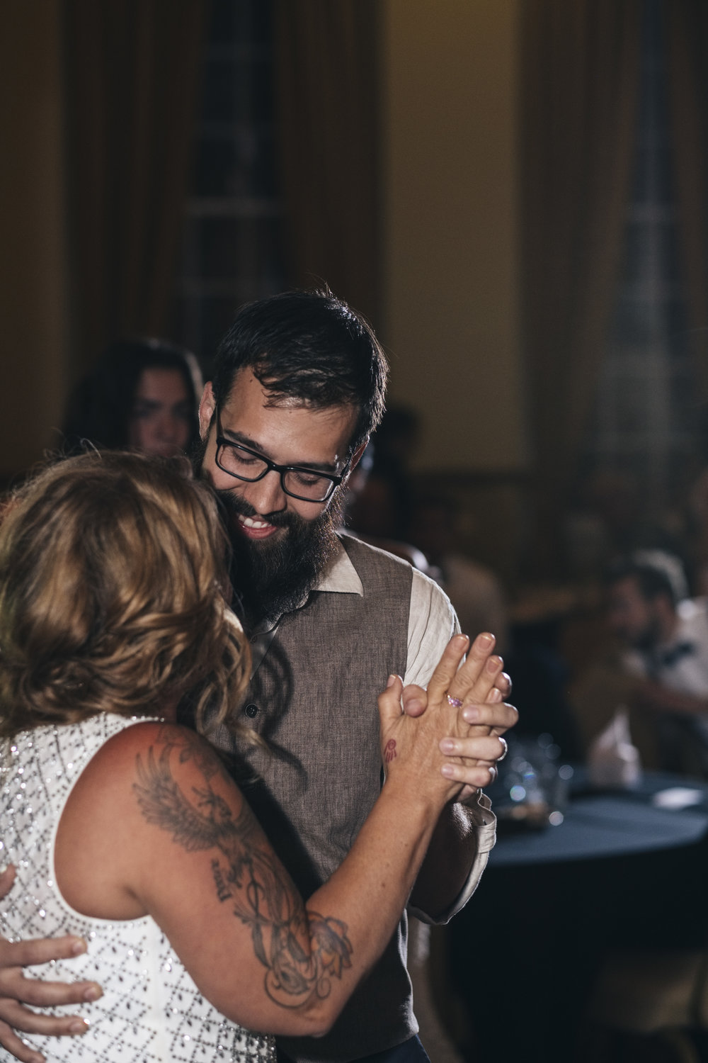 Groom and Mother of the Groom Share First Dance at Wedding Reception in Toledo Ohio with Wedding Photographers
