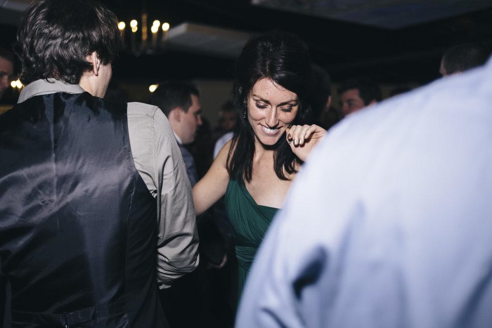 Bridesmaid Dances at Wedding Reception with Photographers from Toledo Ohio