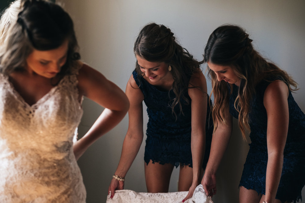 Toledo Area Wedding Photographers with Bride and Bridesmaids Getting Ready for Ceremony