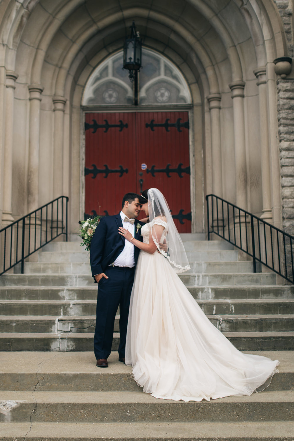 Northwest Ohio Wedding Photographers Capture First Look Experience with Couple at Church on Wedding Day