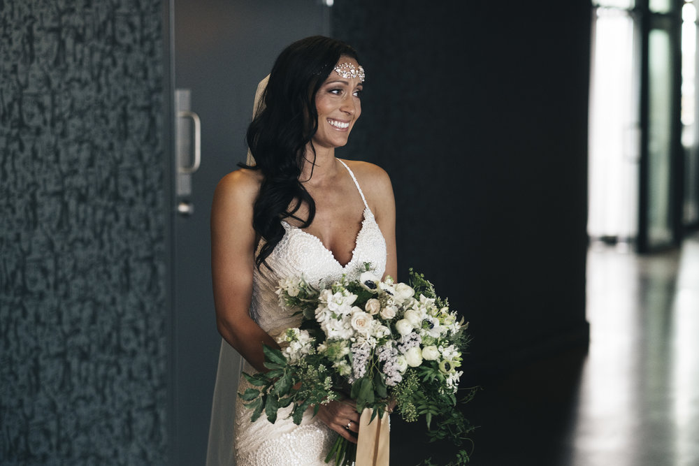 Bride on Wedding Day Sharing First Look with Toledo Ohio Wedding Photographers and Groom Before Ceremony
