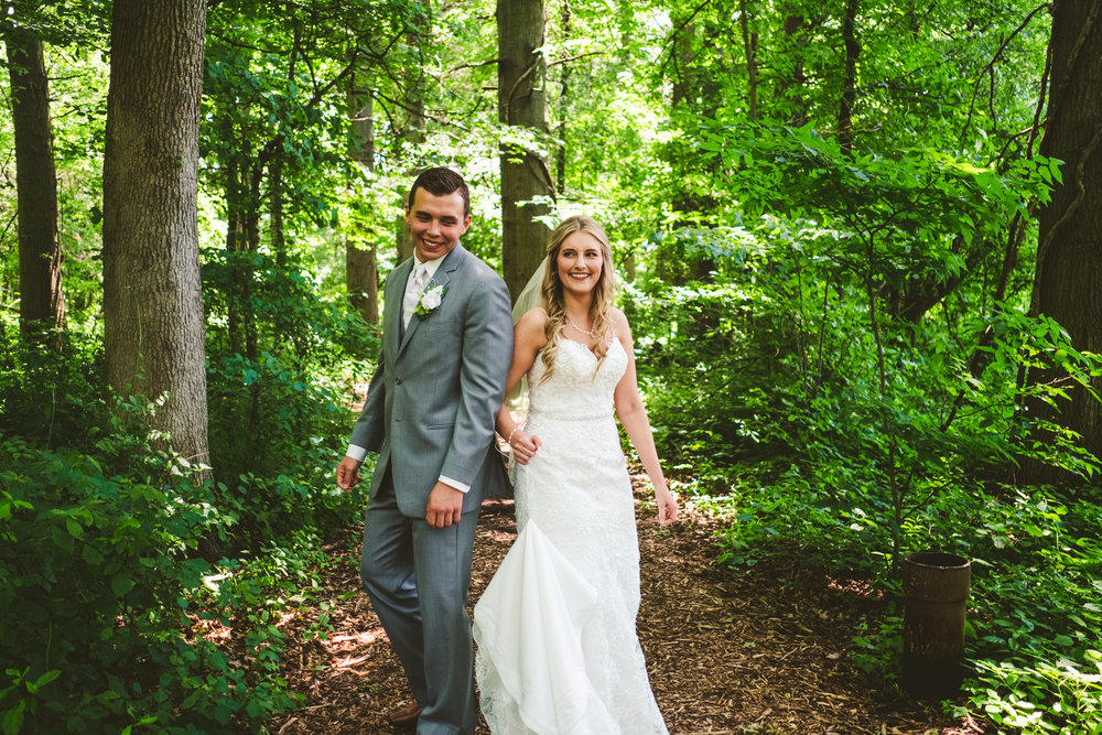 Couple on Wedding Day at Wintergarden Park with Toledo Wedding Photographers as they Share Their First Look Experience