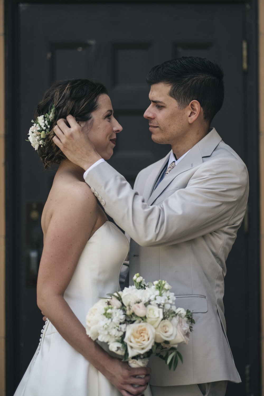 Couple from Toledo Ohio Before Wedding Ceremony with Photographers Outside of Church