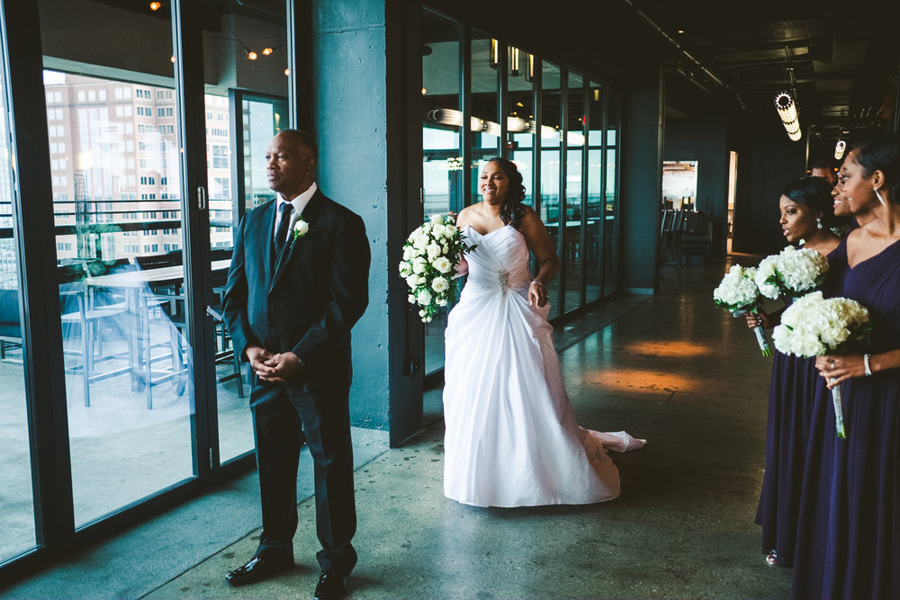Bride and Father Share First look On Wedding Day in Toledo Ohio with Wedding Photographers at the Toledo Renaissance Hotel