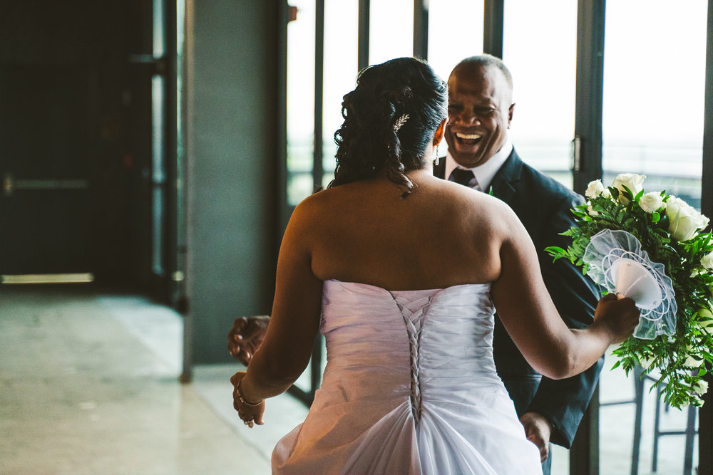 Father of the Bride and Bride During their First Look at The Heights Toledo at the Downtown Toledo Renaissance Hotel