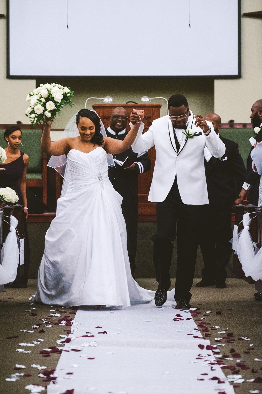 Bride and Groom Exit Ceremony with Toledo Ohio Wedding Photographers