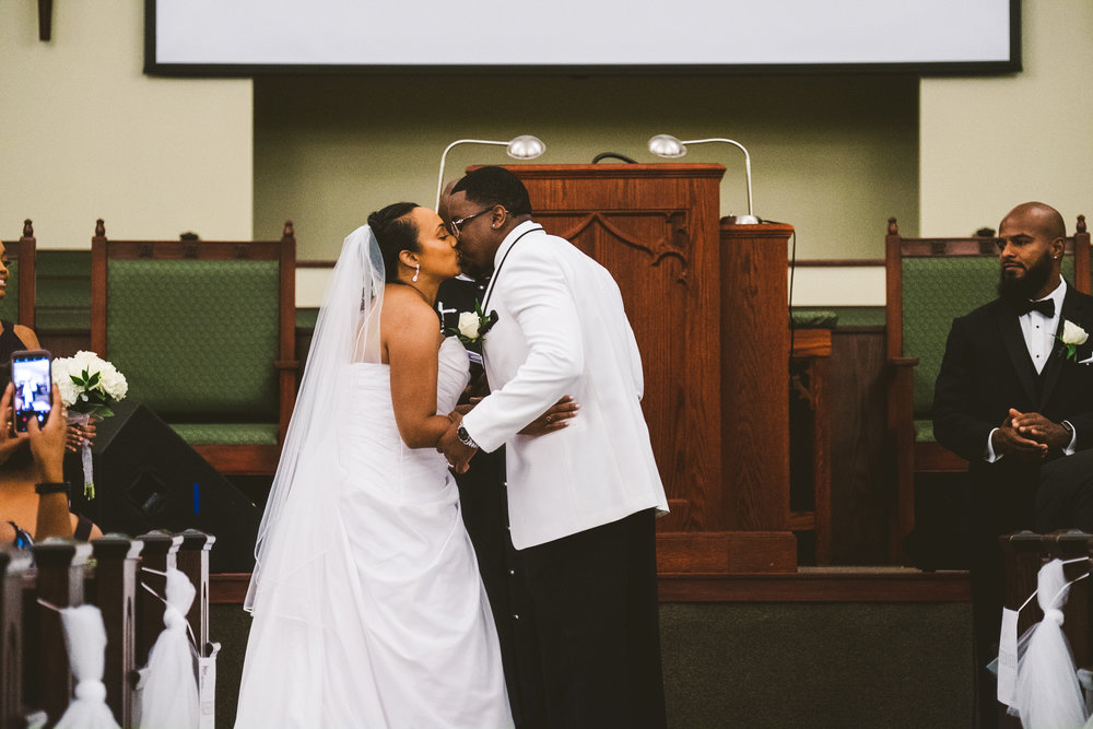 Bride and Groom from Toledo Ohio at their Ceremony with Wedding Photographers from the Area