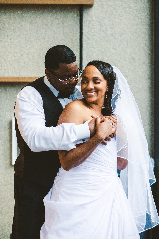 Toledo Couple with Wedding Photographers at the Toledo Renaissance Downtown Hotel on Wedding Day