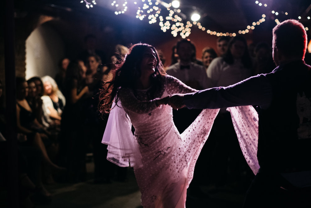 Groom Spins Bride during First Dance in Ypsilanti Michigan's Bona Sera for Reception with Toledo Ohio Wedding Photographers