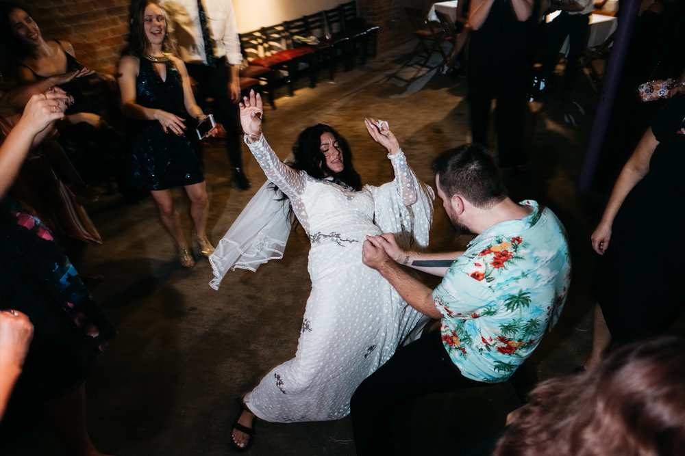 Ypsilanti Couple Dances at Reception in Bona Sera Restaurant with Northern Ohio Wedding and Destination Photographers