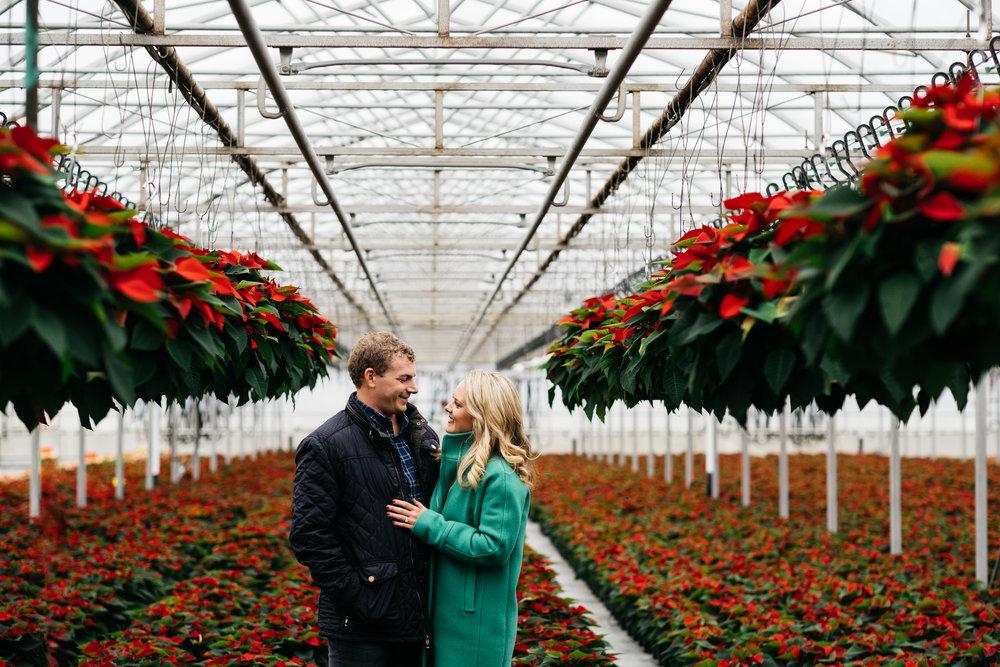 Toledo Ohio Couple During Engagement Session at Greenhouse in Northwest Ohio with Photographers