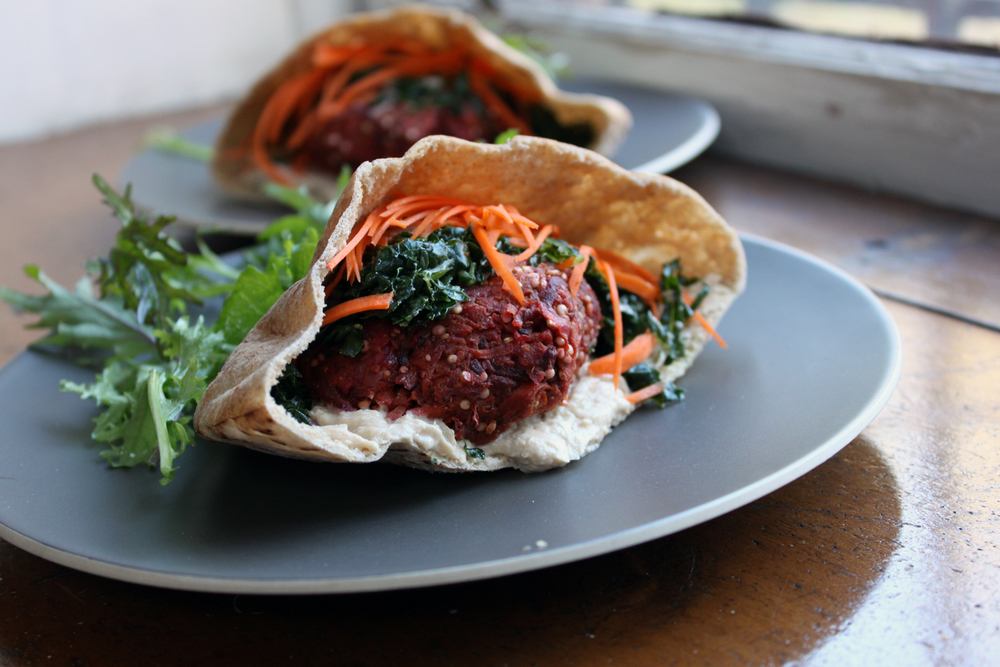 Veggie Burger Pitas with Massaged Kale, Carrots, and Hummus