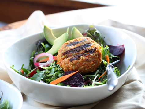 Veggie Burgers over Green Salad with Pickled Onions