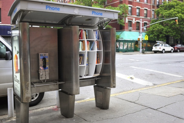 """John Locke, Columbia architecture grad has slipped around Manhattan with a sack of books + custom-made shelves, converting old pay phones into pop-up libraries."""