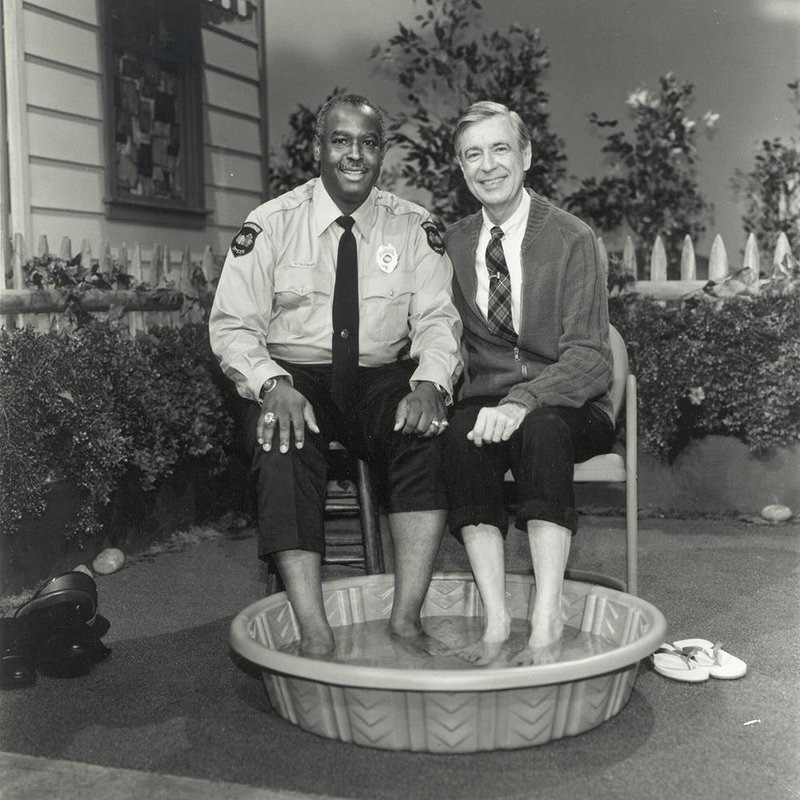 Officer Clemmons and Mister Rogers, reprising their 1969 foot bath more than two decades later, during their final scene together in 1993.  (c) The Fred Rogers Company