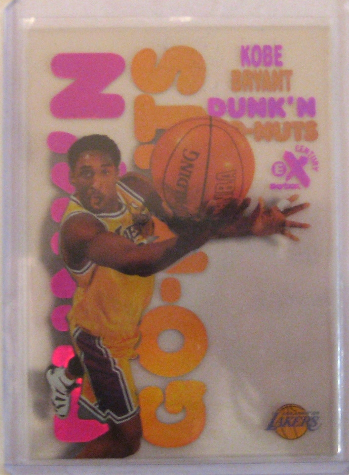 """1998-99 Skybox E-X Century Dunk 'N' Go Nuts: This is another one to file under the """"Who came up with this idea?"""" heading.Did the people at Dunkin' Donuts approach the card company? Did the card designer think it was a funny parody? Skybox certainly seemed to have a sense of humour with some of its designs, and it makes for a fun insert."""