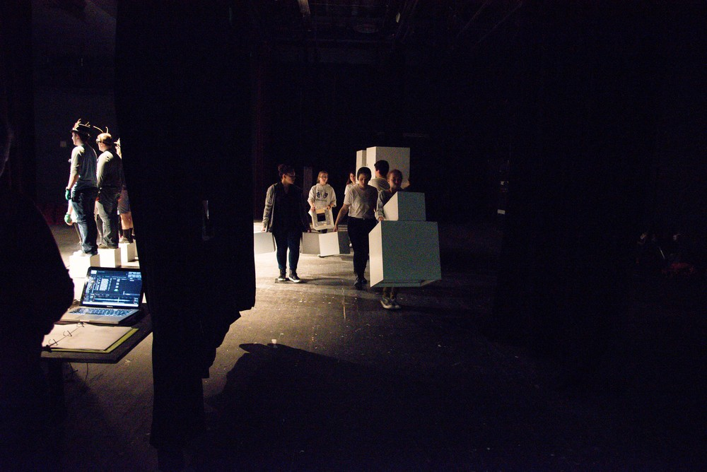 The run crew removes the set while the cast finishes the last scene in the one act version of Alice in Wonderland