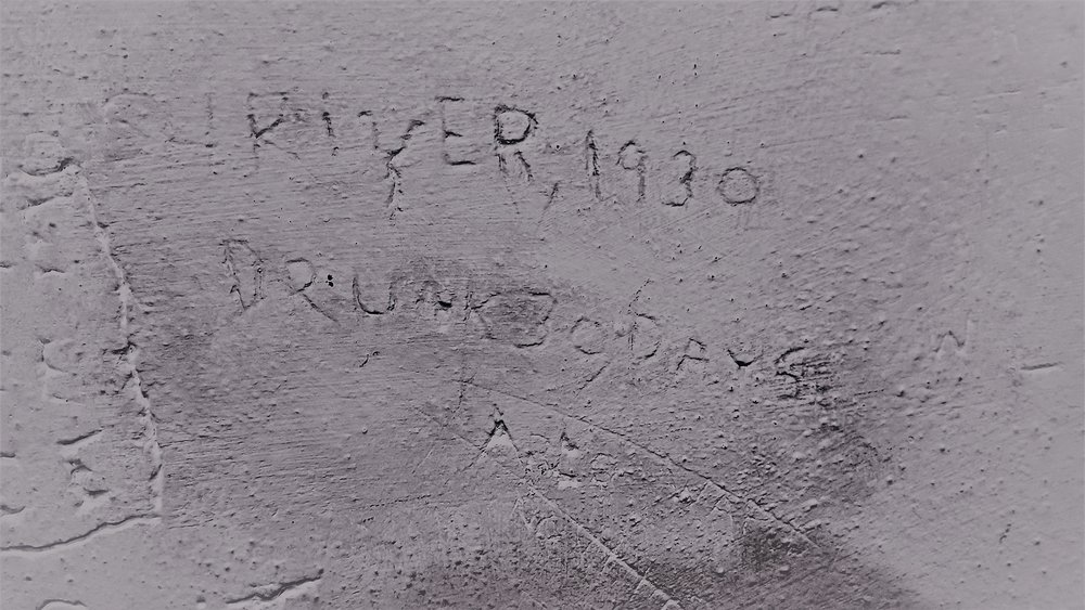 """""""…RIVER 1930… DRUNK 30 DAYS"""" Historical Graffiti in Bellingham's old jail in the basement of old city hall, now home of the Whatcom Museum of History and Art."""