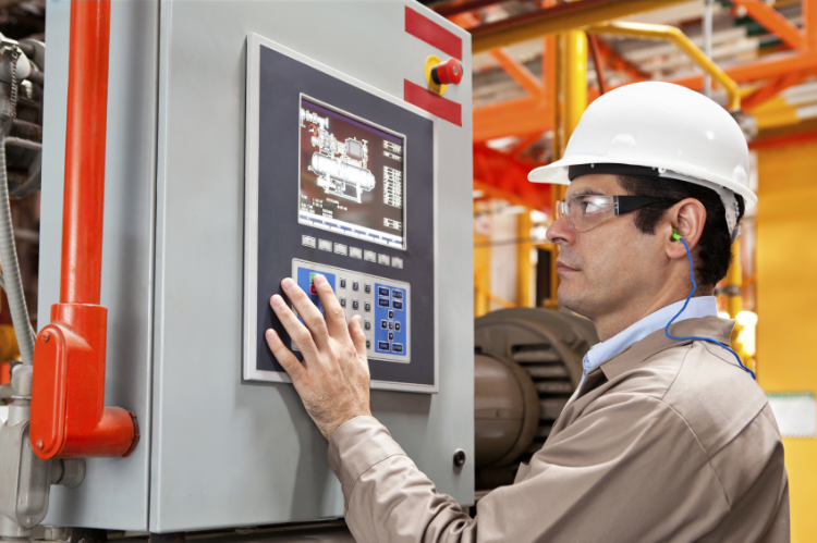 Worker using HMI on Control Panel