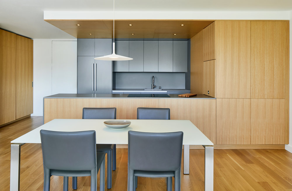 White Oak and Grey Kitchen and Dining Room - Apartment Renovation, Chicago