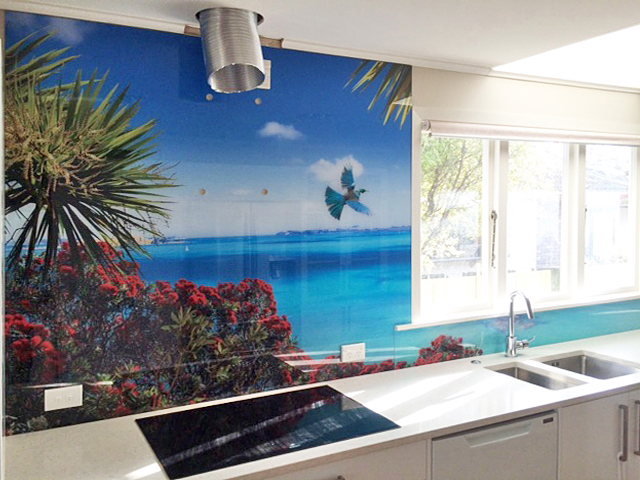 Multi-piece splashback - Often splashbacks can be created to go under windows and around corners.   This photo was taken before the rangehood was installed so the splashback goes behind the rangehood and to the ceiling.Image : Achilles Point Lookout - custom design