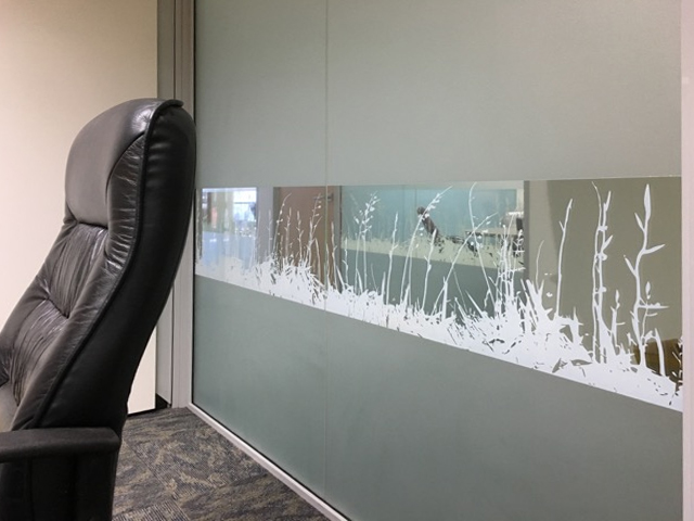 FLAX WINDOW FILM - - This office wanted frosted privacy films installed on their glazing partitions but also a section of clear film with a feature flax pattern for interest.  - We used a photograph of flax silhouettes and changed it to a graphic that repeated and printed white ink onto clear film.