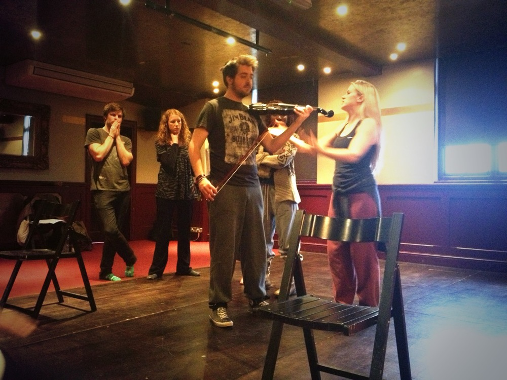 Poet (Thom Short) with violin and dancers, Rat  (Josie Beth Davies, Miranda Colmans, and Mark Lee)