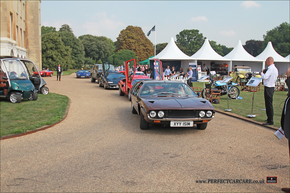 Beautifully maintained 1974 Lamborghini Espada S3 pulls round to the main stage to recieve its third in class trophy. Owners have owned this car from new and was truly part of their family.