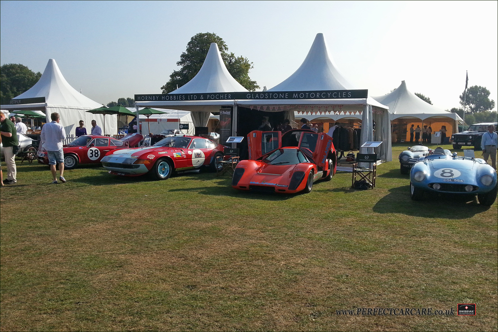 Mclaren M12 Coupe, Jaguar D Type, Ferrari Daytona and Abarth Simca sit in the sun on the lawns of Syon Park.