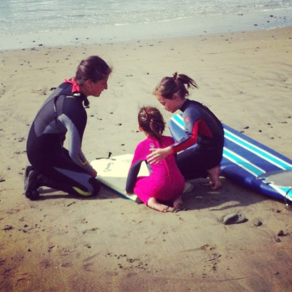 Simona teaching wave safety to 5 and 8 year old sisters