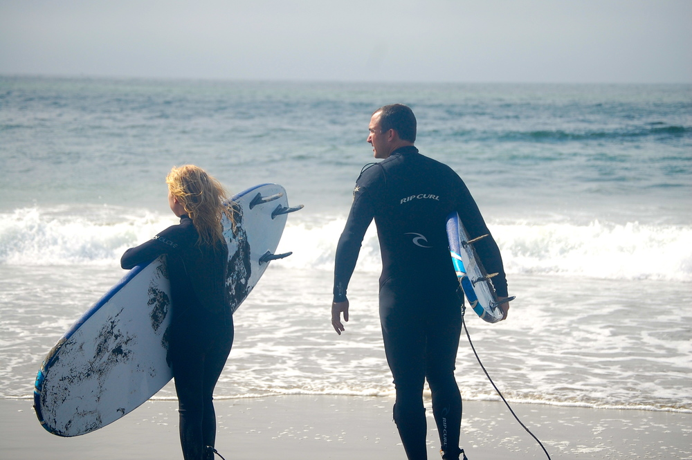 Father and daughter (12 years old) team up for a surf lesson
