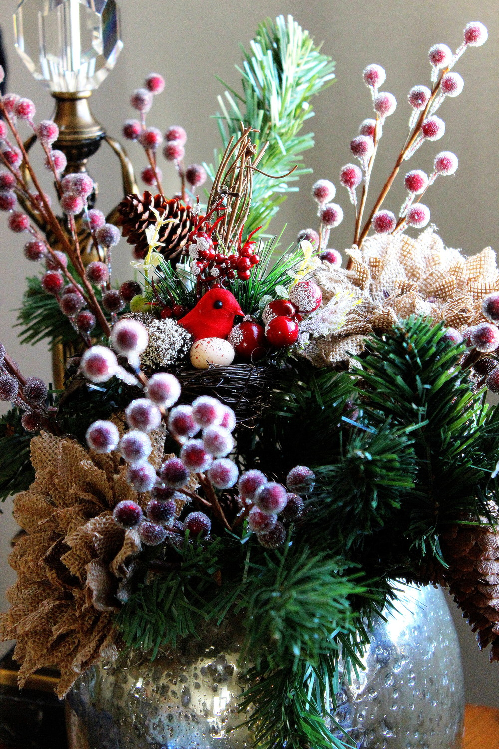 Christmas arrangement created out of flowers purchased at Hobby Lobby