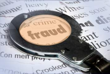 Picture of magnifying glass over the words 'crime' and 'fraud'