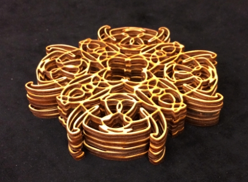 "Laser-cut 1/8'' birch plywood. Laser cut image hand drawn and CAD designed. The laser cutter is awesome. Also part of the ""Theme and Variation"" multimedia work currently on display in the Glass Box Gallery at Colorado State University. Copyright Cei A Lambert 2013"