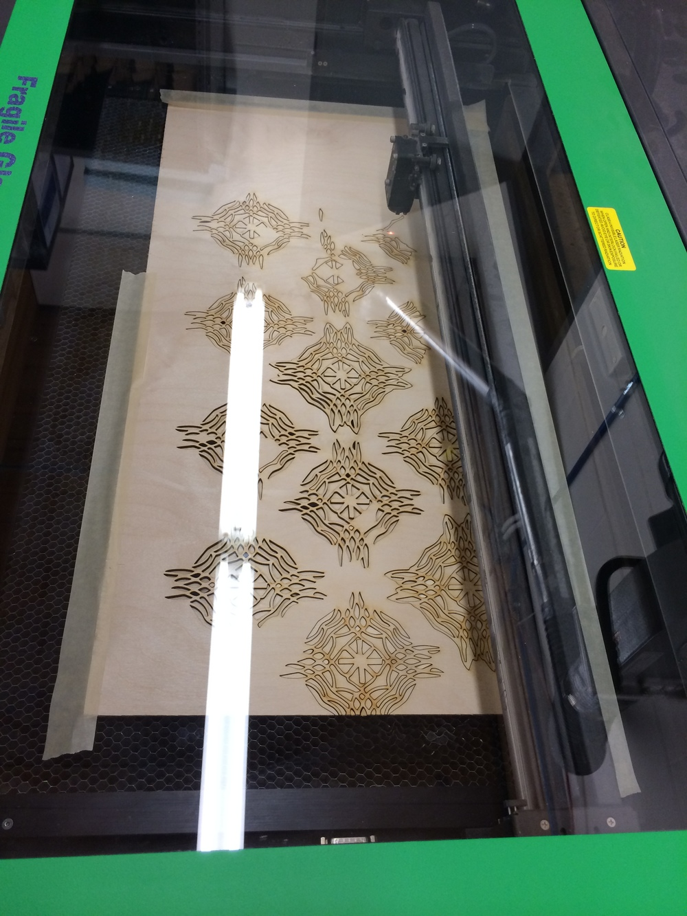 The laser cutter is a lot of fun. Here I'm cutting out hand-drawn knotworks for a test installation. February 2014