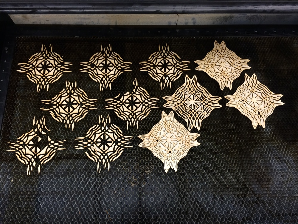 More laser cutter. I'm hoping to find a way to preserve the negatives of the cutouts. February 2014