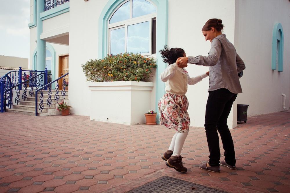Yusrah showing off her dancing skills with CLEMC head teacher Amanda