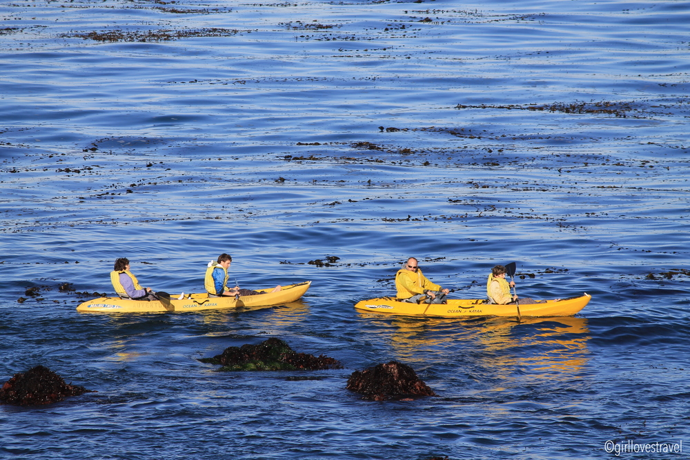 Kayaking at Lover's Point, Yellow Kayak, People kayaking, pacific grove kayaking, kayaking in monterey, what to do in pacific grove, water activities pacific grove, kayaking in cold water, lovers point california, lovers point pacific grove