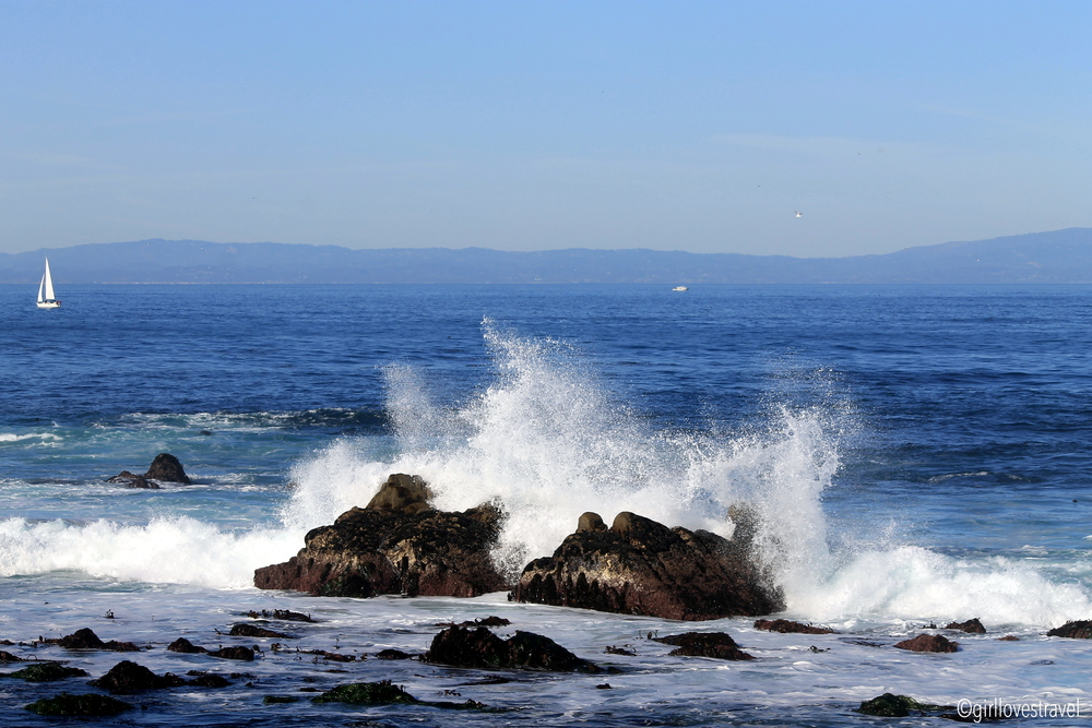 pacific grove crashing waves, sail boats in pacific grove california, crashing waves on rocks, waves in cold water, surfing in pacific grove california, water temperature pacific grove, big sur waves