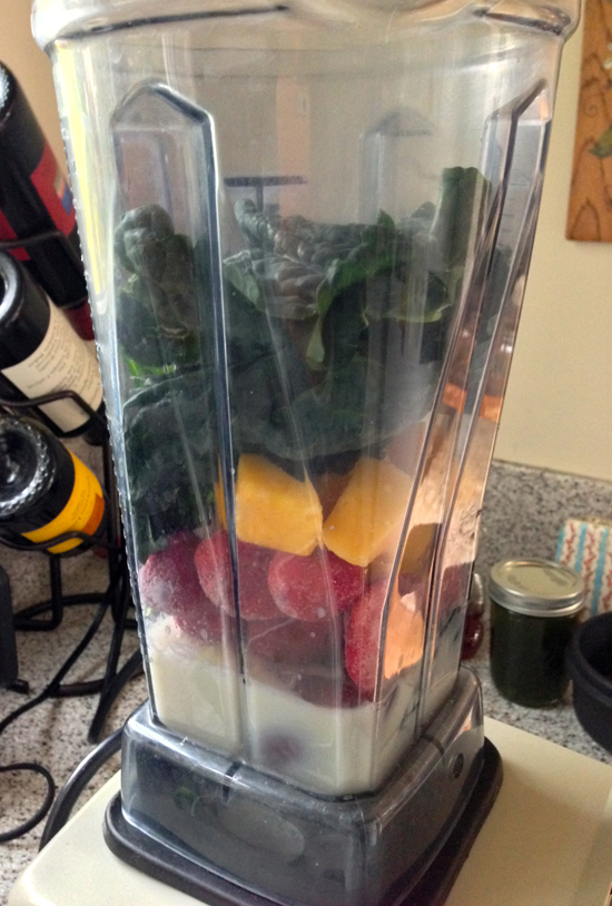 tropical green smoothie, green smoothie recipes, healthy green smoothie recipe, green juice recipe, using kale in smoothies, green smoothies that taste good, mango green smoothie, smoothie with kale strawberries mango peaches almond milk, healthy happy 2014, girl loves food, vitamix