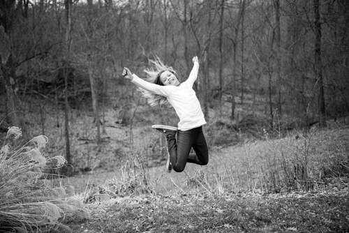 girl-blackandwhite-jump-action