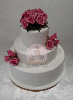 White Stenciled Wedding Cake with Lilac Roses