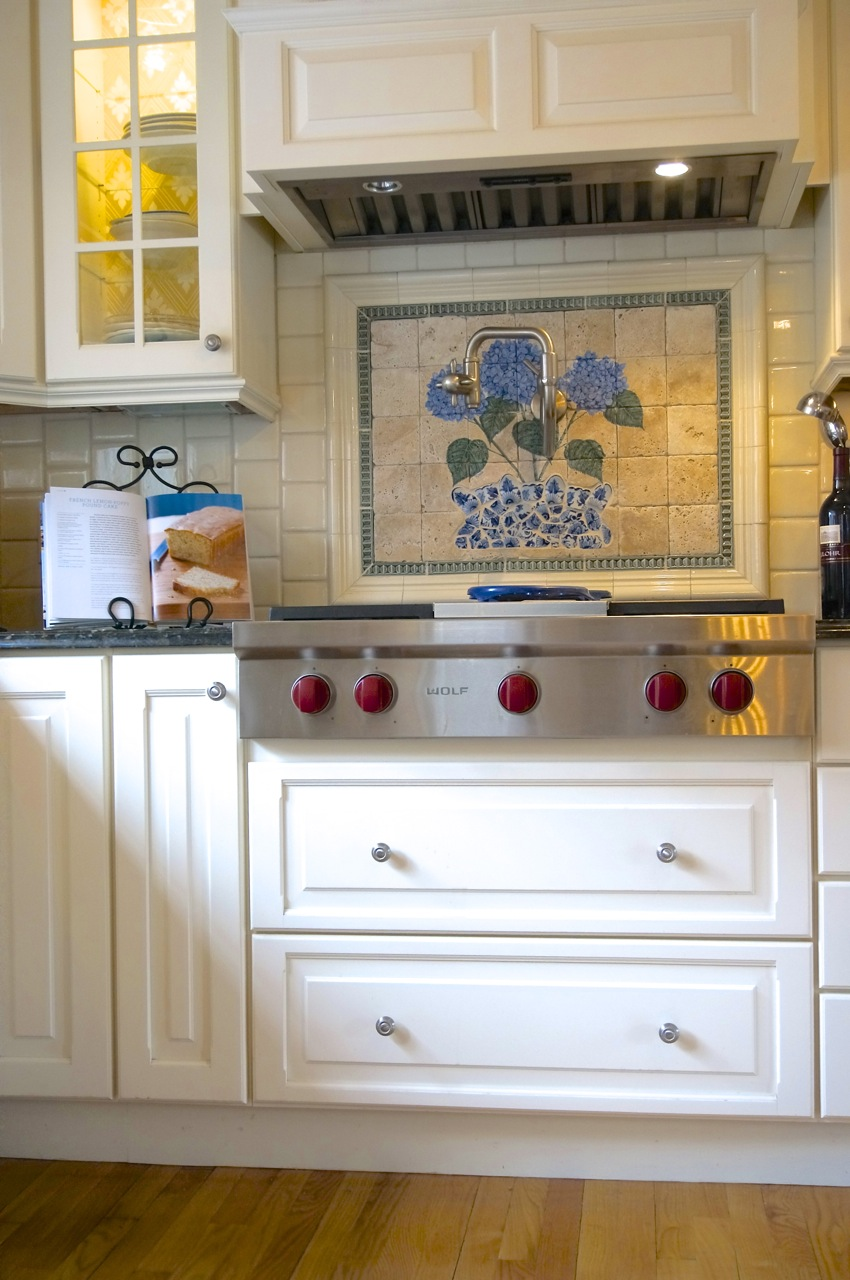 Tiled Kitchen wiith Builtins and Wolf Range.jpg