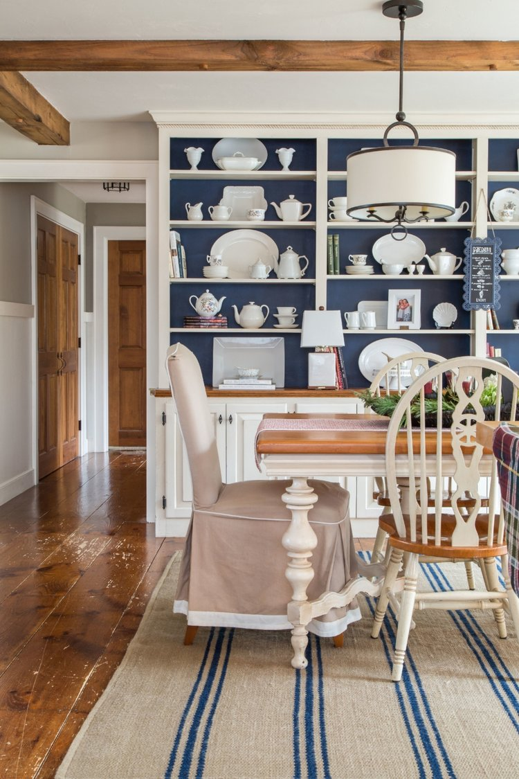 Notice the timber beams and wide-plank flooring. Design by Bee's Knees.