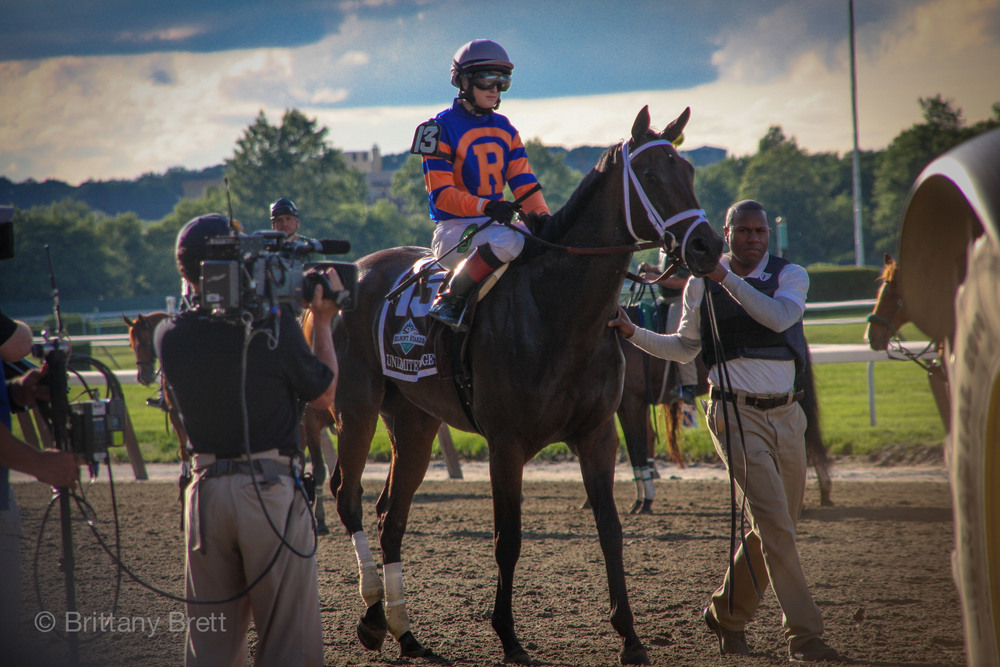 'Unlimited Budget' and Rosie Napravnik at the starting gate of the 2013 Belmont Stakes.
