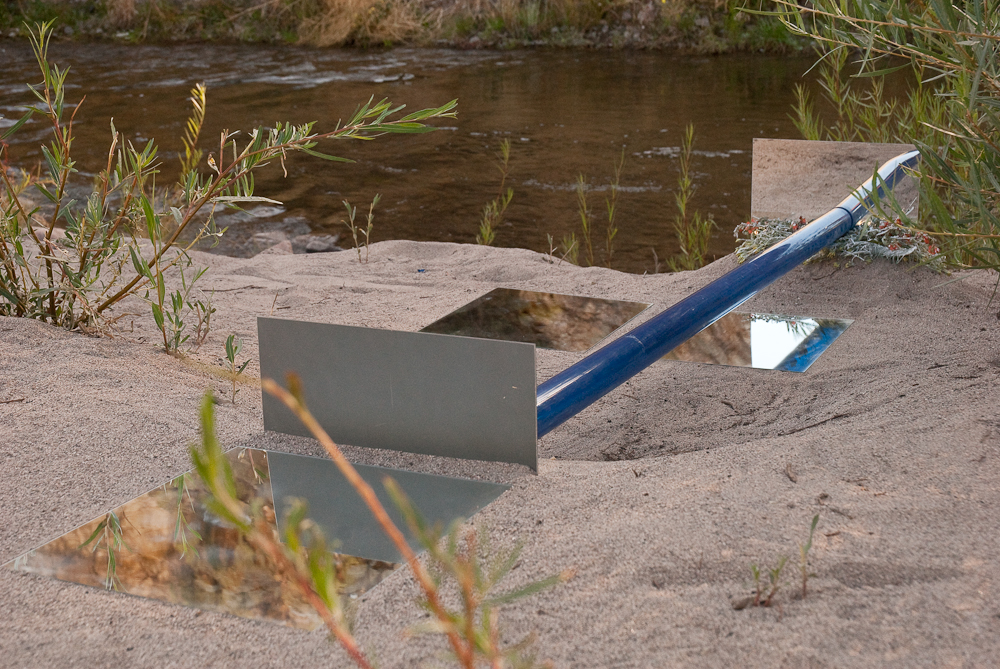 mirrors and blue acrylic tube inset into sand along the Gila River New Mexico, 2009